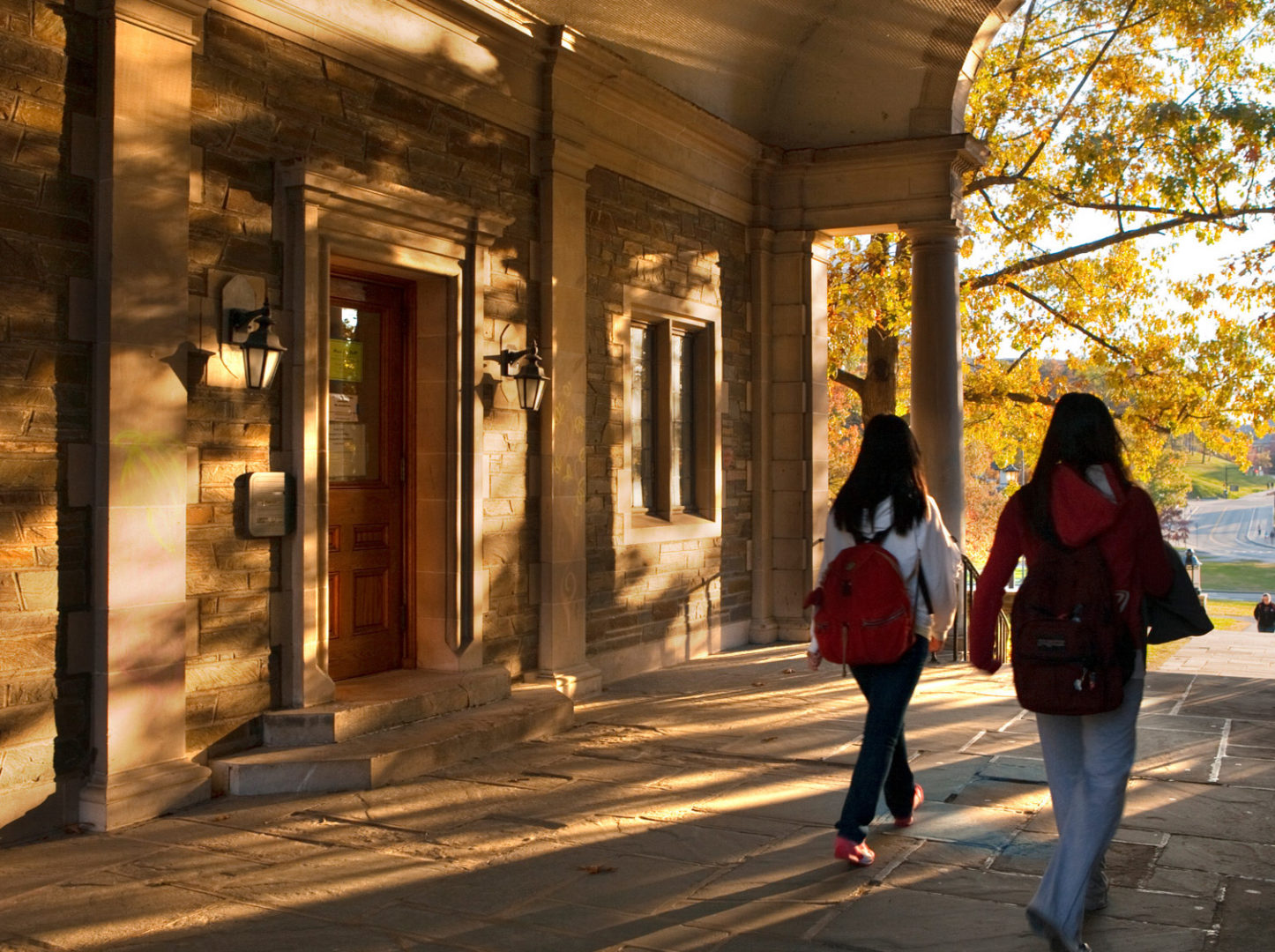Students walk through the Balch Hall archway in fall.
