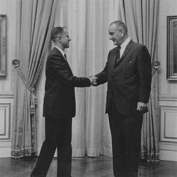 Craig Voorhees shaking hands with President Lyndon B. Johnson