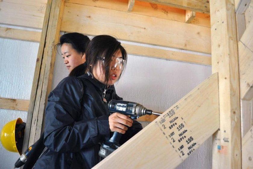 Alternative Break students building a barn