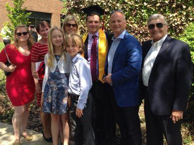 Members of the Gancas family celebrate a 2014 graduation