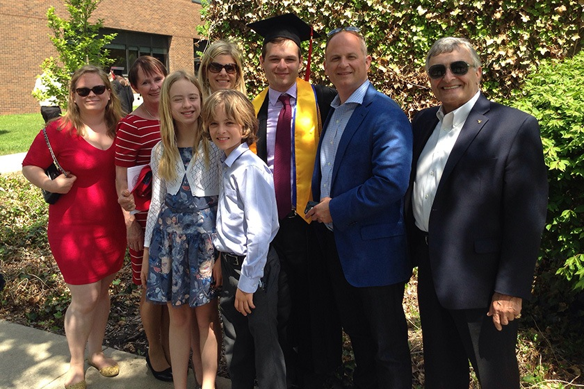 Members of the Gancas family celebrate a 2014 graduation