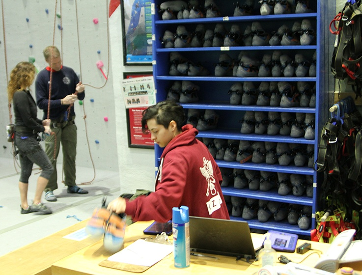 Sofia Villacreses '19 working her weekly shift as a climbing czar at the Lindseth Climbing Center.