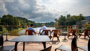 The Treman Family Terrace at the Martin Y. Tang Welcome Center provides sweeping views of Beebe Lake, portions of the Cornell Botanic Gardens, and campus.