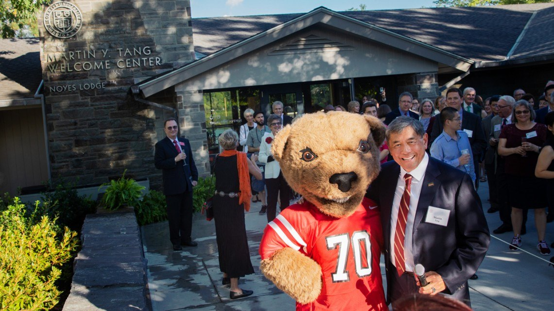 Martin Tang with the Big Red Bear at the official dedication of the Martin Y. Tang Welcome Center.