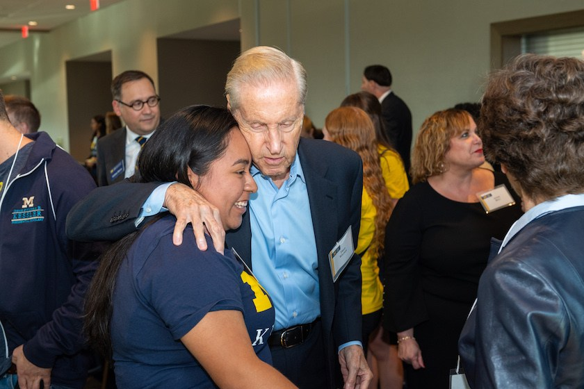 Erica Gonzalez-Paramo, a Kessler Scholar at the University of Michigan, greets Fred Wilpon at the Kessler Annual Dinner in September 2018.