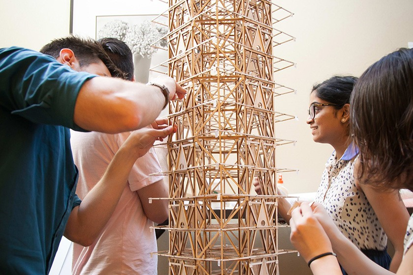 The Cornell Seismic Design Team repairing its wooden tower