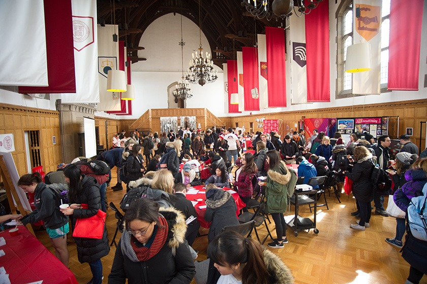 Students, faculty, and staff in the Memorial Room of Willard Straight Hall
