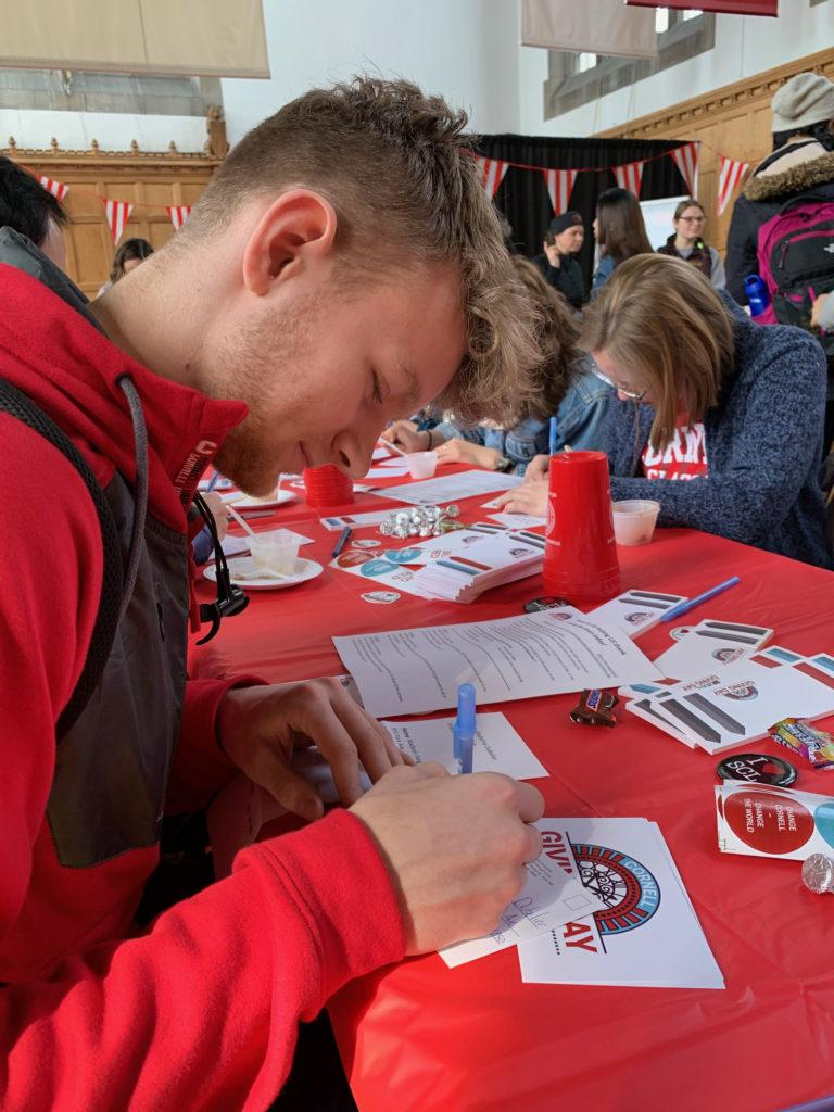 First-year student Fridrik Diehl, Class of 2022, writing thank-you cards to Giving Day donors.