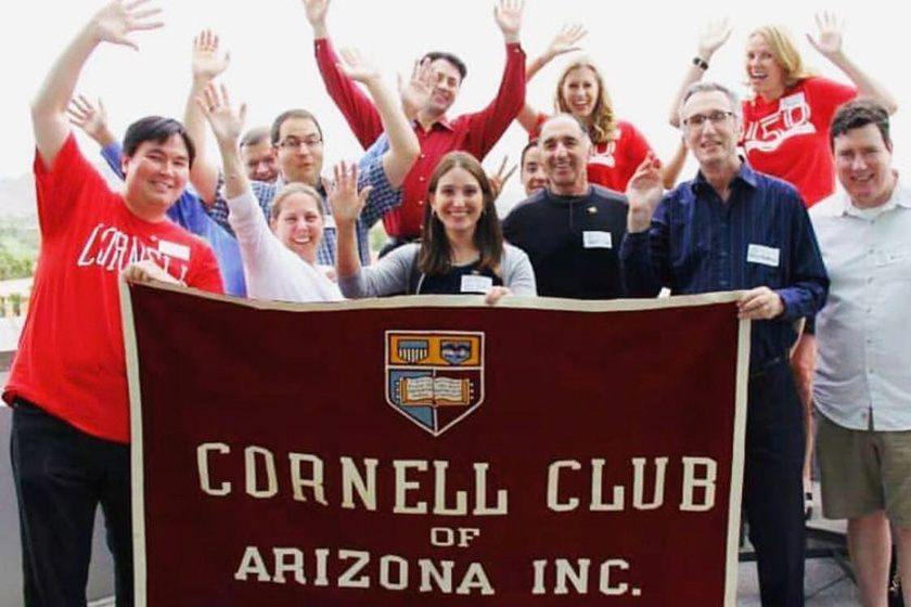 Members of the Cornell Club of Arizona with a banner