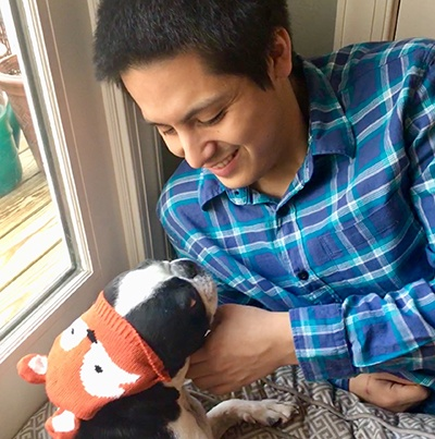 Bryan Scanapieco, Class of 2019, enjoying time with Luigi, his Boston Terrier.