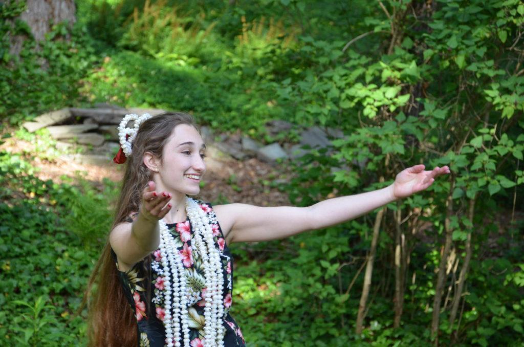 Boucher dancing hula.