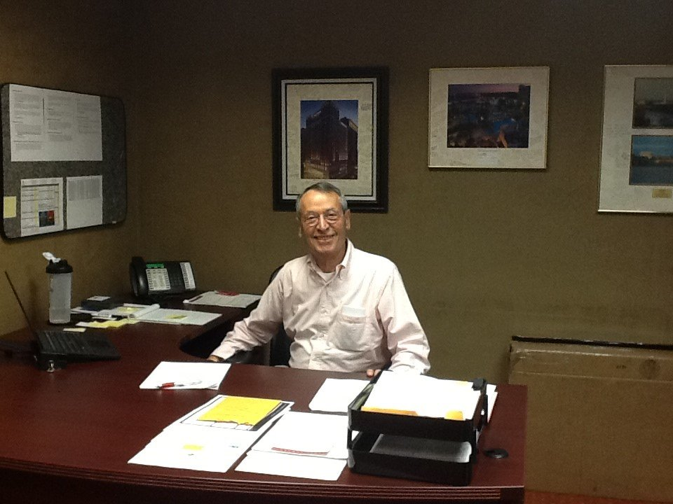 Androulakis at his desk at the Marriott in Kansas City, where he worked as general manager.