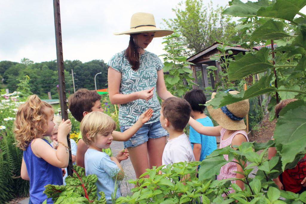 Hopkins-Hensley working with local kids in the Ithaca Childrens Garden as part of her horticulture internship in summer 2017.