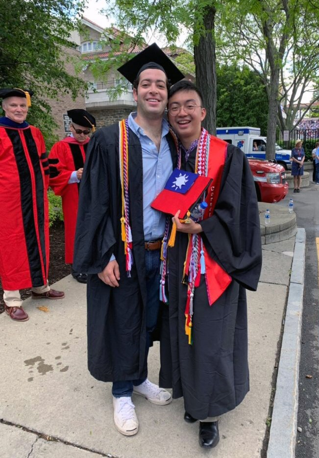 Will Gusick (left) and Dustin Liu (right) at graduation wearing their cords.