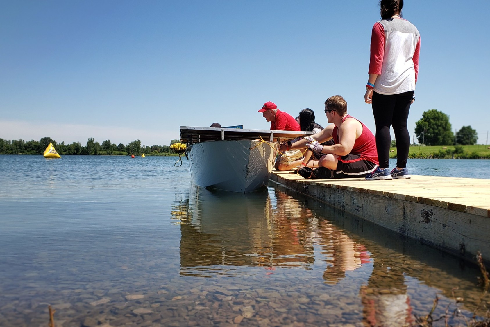 Members of the Cornell Solar Boat team prepare their solar-powered craft for the Solar Splash intercollegiate competition.