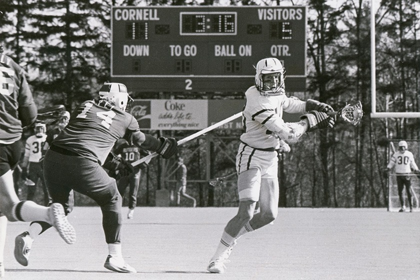 Two lacrosse players in action during a game