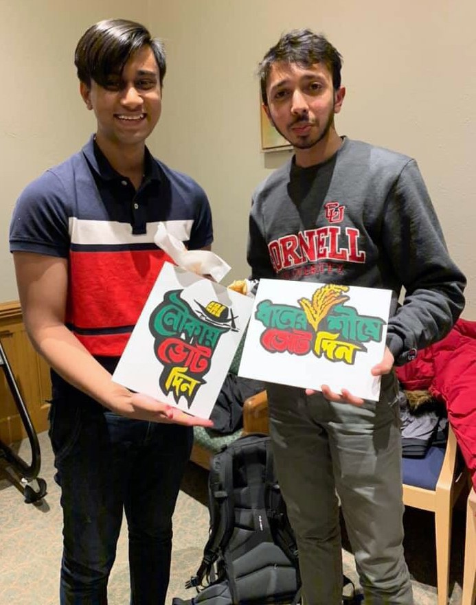 Umran and a fellow Bangladeshi student display the paintings they created at the 'Chai and Paint' Bengali Students Association event.