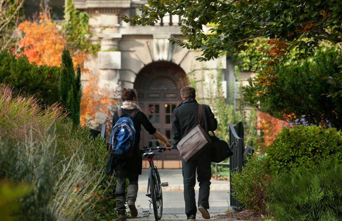 Students walk through Minns Garden towards the Plant Sciences Building in fall.