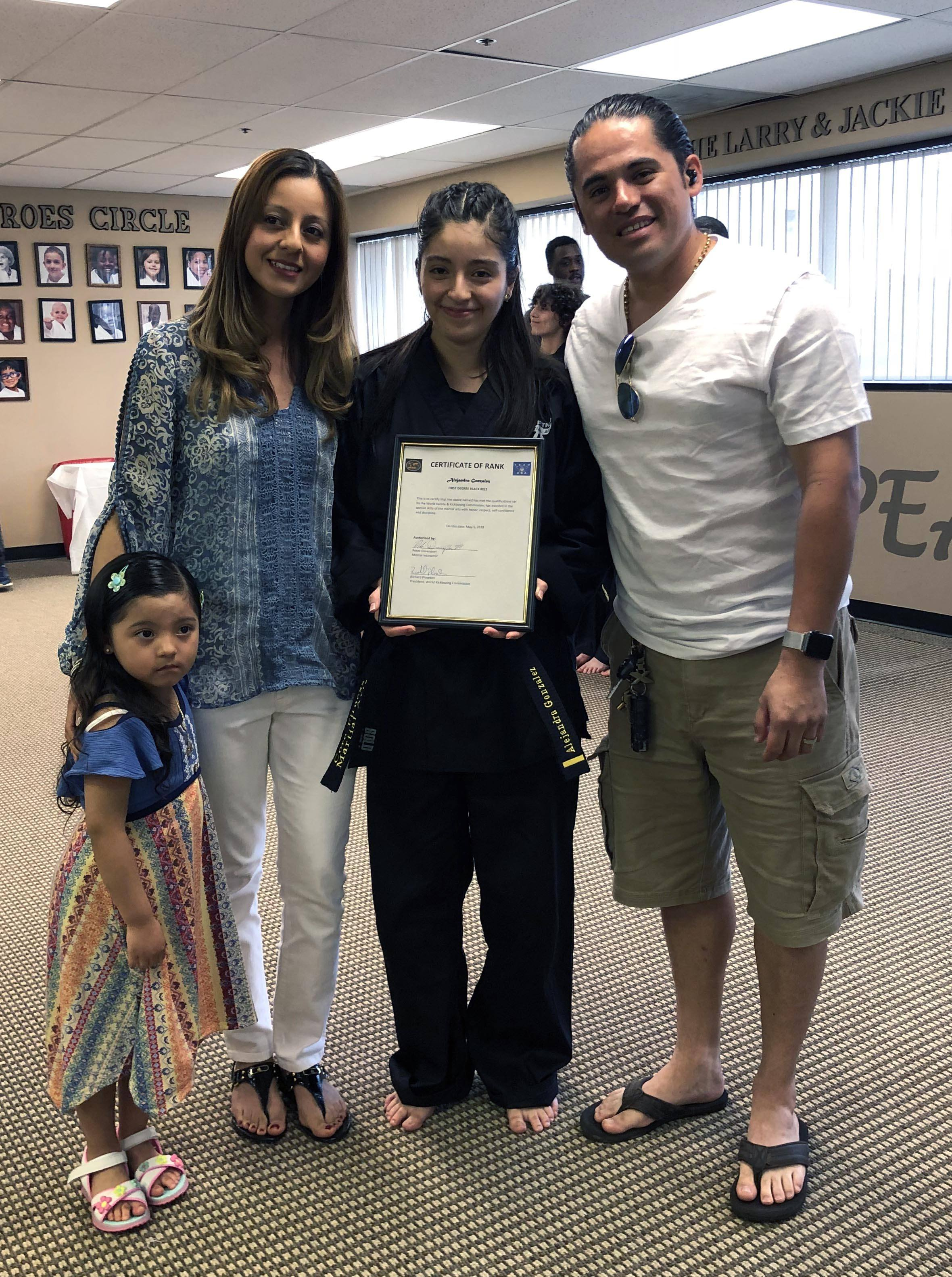 (L to R) Megan Gonzalez (sister), Noemi Rivera (mother), Alejandra Gonzalez, Alejandro Gonzalez (father). Alejandra received her first-degree black belt in karate in May 2018.