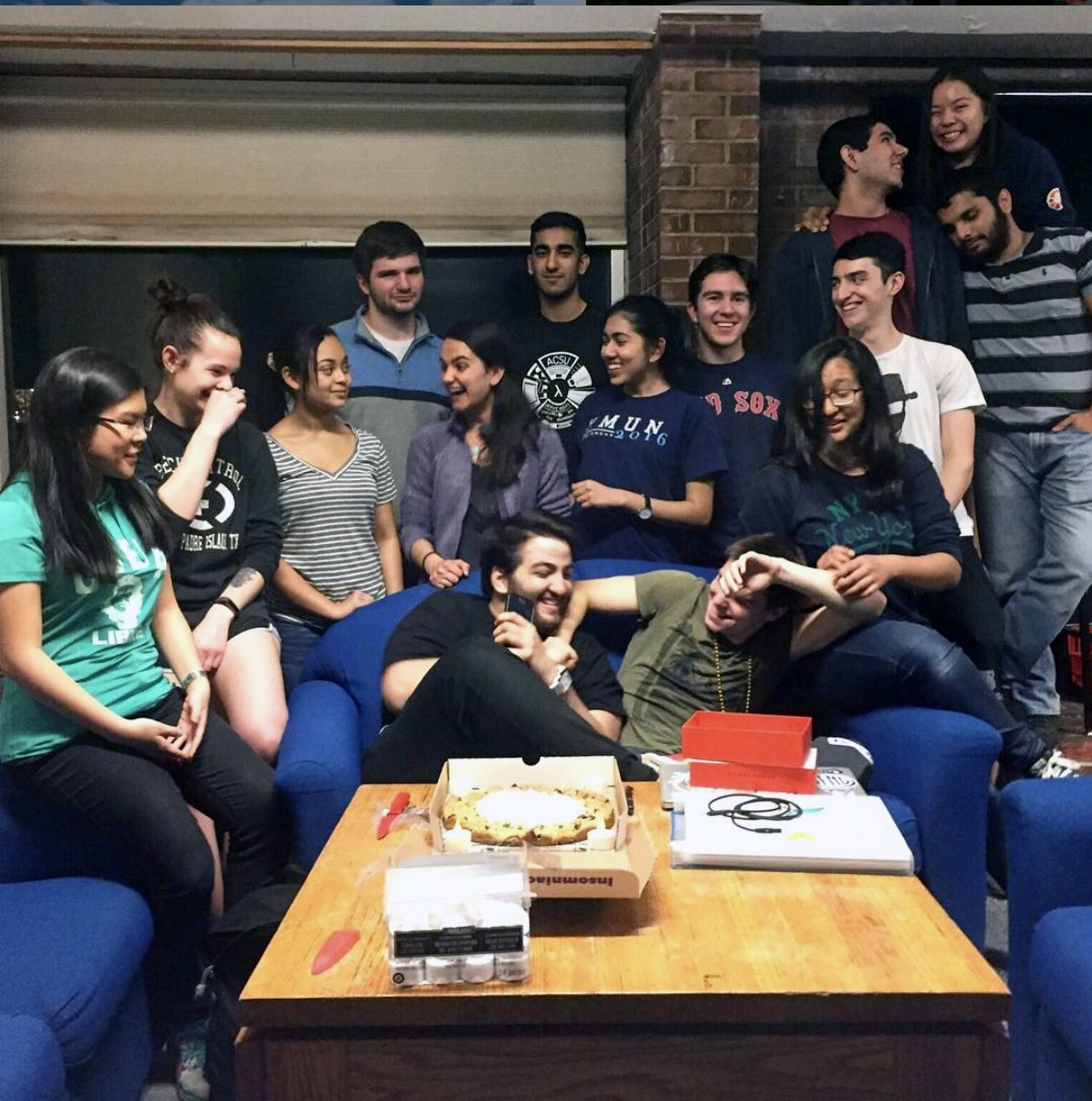 Ben (center) and his friends in the lounge at Holland International Living Center, the residence hall where they met four years ago.