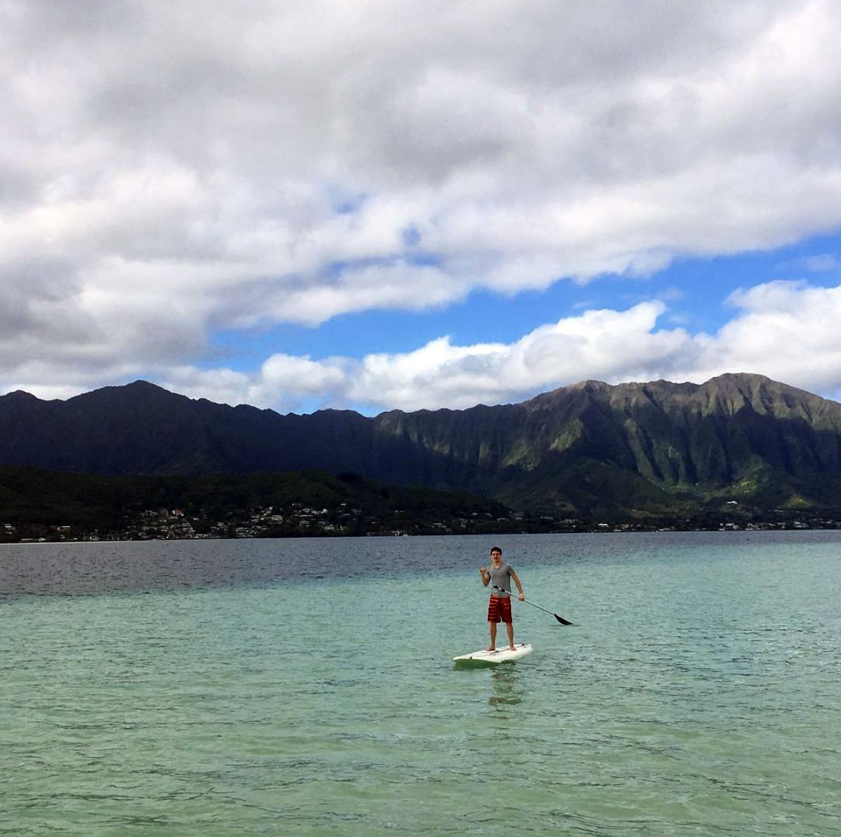 Stand-up paddle boarding in Kane'ohe Bay in Hawai'i.