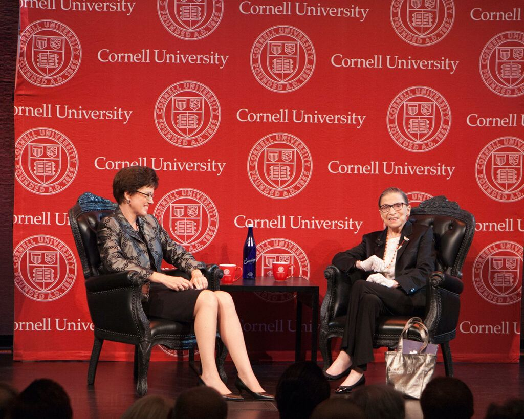 Justice Ruth Bader Ginsburg on stage with Dean Gretchen Ritter.