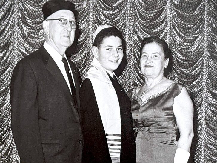 Kram at his Bar Mitzvah in 1963, with his grandparents, Anna and Hyman Greenberg.