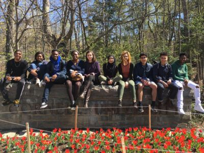 Posse students sit on the Cornell University stone wall