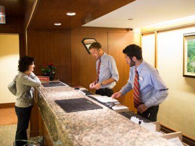Hotel Administration (SHA) students work the Statler Hotel front desk
