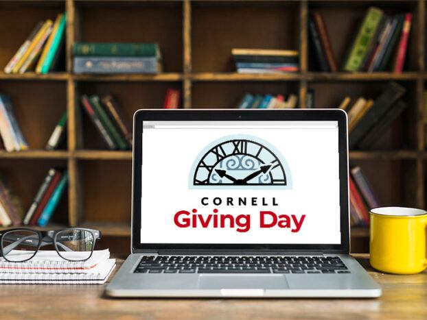 Laptop with Giving Day logo