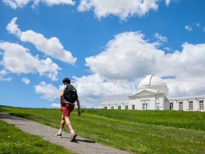 Clouds float past Fuertes Observatory on North Campus.