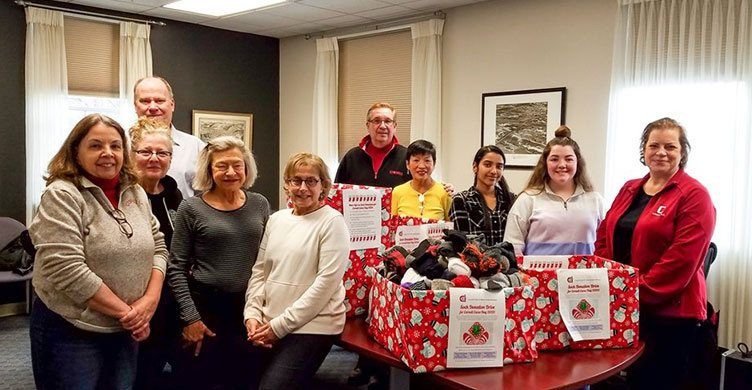 Cornell Club of Ithaca members participate in a sock drive in January 2020.